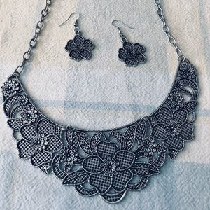 Silver statement necklace and earrings set